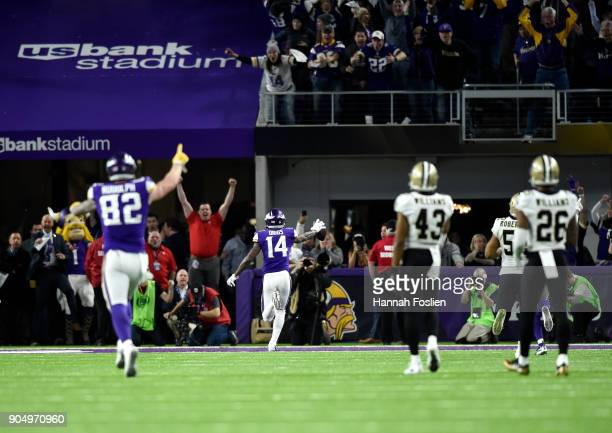 Stefon Diggs of the Minnesota Vikings runs with the ball to score a touchdown and with as time expired in the NFC Divisional Playoff game against the...