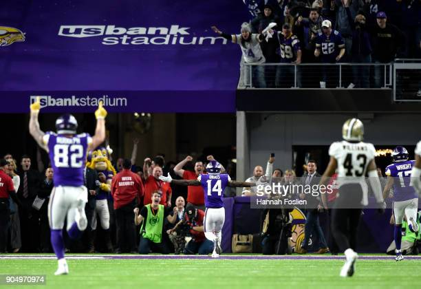Stefon Diggs of the Minnesota Vikings runs with the ball to score a touchdown as time expired in the NFC Divisional Playoff game against the New...