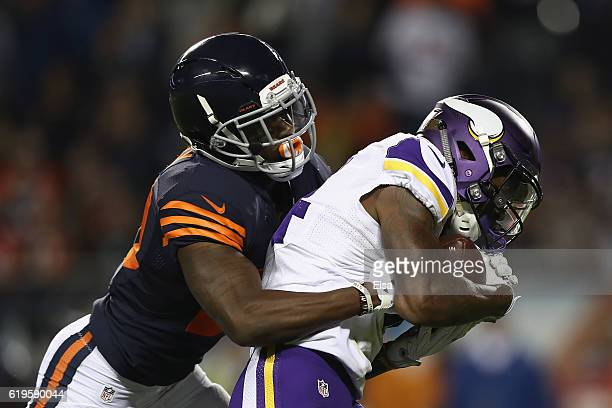 Stefon Diggs of the Minnesota Vikings scores a touchdown as he is defended by De'Vante Bausby of the Chicago Bears during the fourth quarter of their...