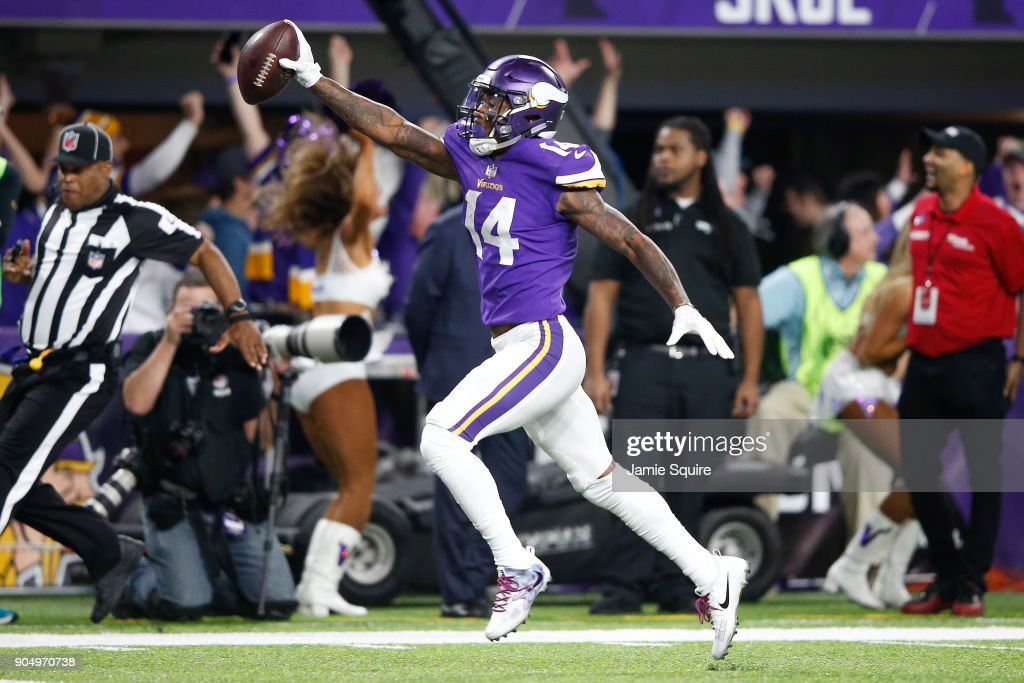 Stefon Diggs #14 of the Minnesota Vikings scores a touchdown as time expires against the New Orleans Saints during the second half of the NFC Divisional Playoff game at U.S. Bank Stadium on January 14, 2018 in Minneapolis, Minnesota.