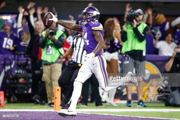 Stefon Diggs of the Minnesota Vikings scores a touchdown as time expires against the New Orleans Saints during the second half of the NFC Divisional...