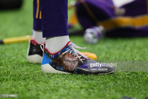 Stefon Diggs of the Minnesota Vikings wears Chucky cleats during the pregame against the Oakland Raiders at US Bank Stadium on September 22 2019 in...