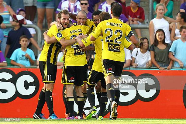 Stein Huysegems of the Wellington Phoenix is congratulated by teammates after scoring the Phoenix's second goal during the round 25 ALeague match...
