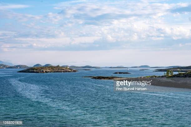 steinkjerringa symbol on the island of luroy in northern norway - finn bjurvoll stock pictures, royalty-free photos & images