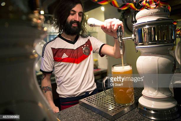 Steins of German beer are poured prior to the FIFA World Cup final in the 'Bavarian Beerhouse' pub in East London on July 13 2014 in London England...