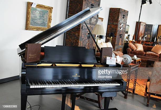 A Steinway and Sons grand piano is displayed with other furnishings during a media preview of the auction of personal property that once belonged to...