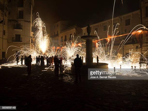 Stelas and sparks of rockets in the street