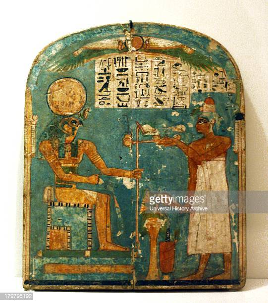Stele depicting a falcon scarab and gods from the new kingdom 19th dynasty 1280 BC