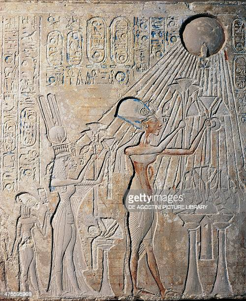 Stele depicting Akhenaten with Nefertiti and their daughters bearing offerings to Aton limestone from Tell elAmarna Egyptian civilisation New Kingdom...