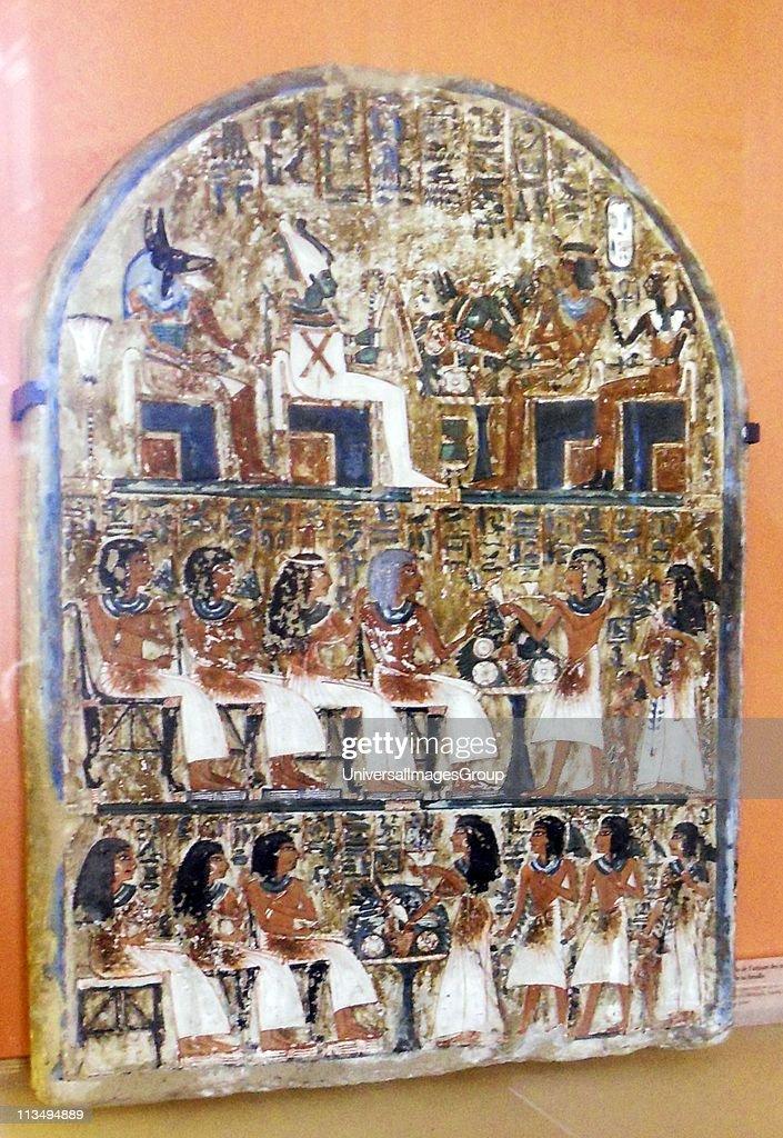 The gods Anubis and Osiris enthroned facing Ahmose Nefertari
