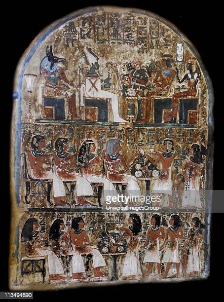 Stele Irynefer Top levelThe gods Anubis and Osiris enthroned facing Ahmose Nefertari and Amenhotep first deified 2nd Level his wife and their...