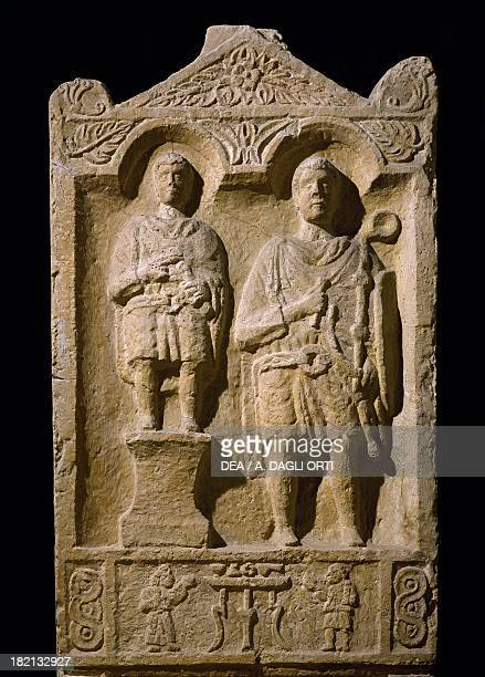 Stele of the buccinator Aurelio Bitone with shield and horn portrait beside his son in military dress reflecting the hereditary nature of service...