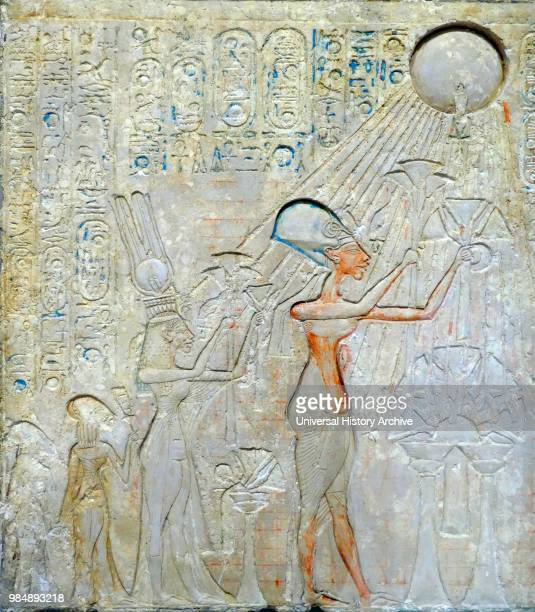 stele representing Akhenaton Nefertiti and daughters worshiping the Aten sun disk King Akhenaten ruled Egypt for about 17 years He changed the state...