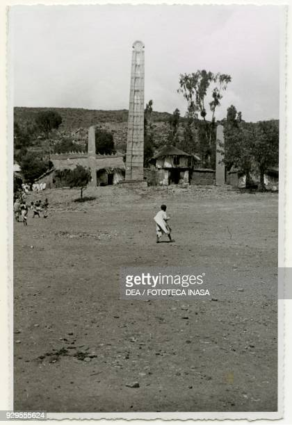 Stele to be transported to Rome with thatched homes in the background Axum Ethiopia photograph by Ugo Monneret de Villard 19351936