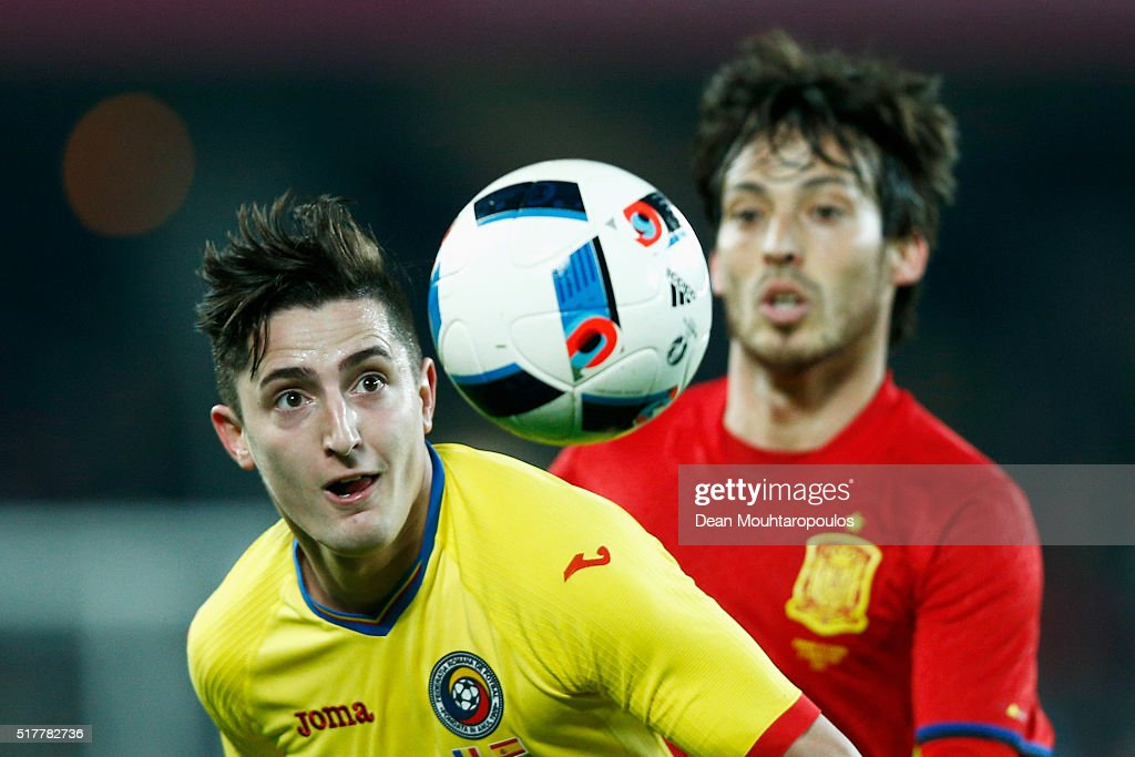 Steliano Filip of Romania battles for the ball with David Silva of Spain during the International Friendly match between Romania and Spain held at the Cluj Arena on March 27, 2016 in Cluj-Napoca, Romania.