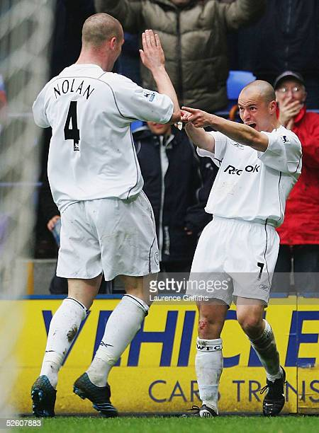 Stelios of Bolton celebrates the third goal with Kevin Nolan during the FA Barclays Premiership match between Bolton Wanderers and Fulham at The...