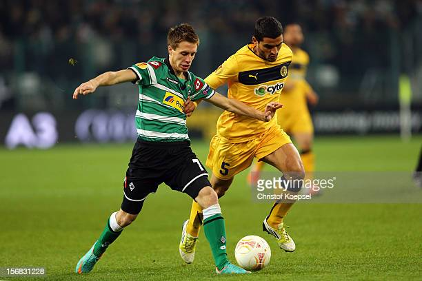 Stelios Parpas of Limassol challenges Patrick Herrmann of Moenchengladbach during the UEFA Europa League group C match between Borussia...