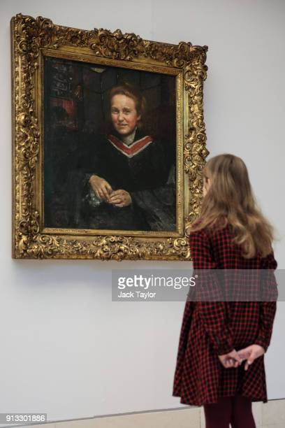 Stella age 9 poses in front of a portrait of suffragist Millicent Fawcett by British artist Annie Swynnerton circa 1899 during a photocall at Tate...