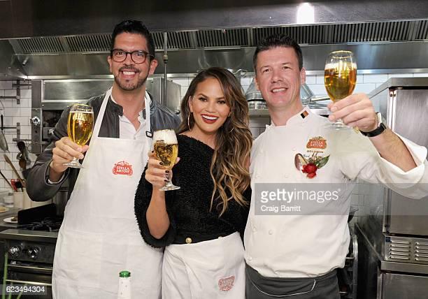 Stella Artois Vice President Harry Lewis Chrissy Teigen and Belgian Chef Bart Vandaele toast to a season of extraordinary hosting at Stella Artois'...