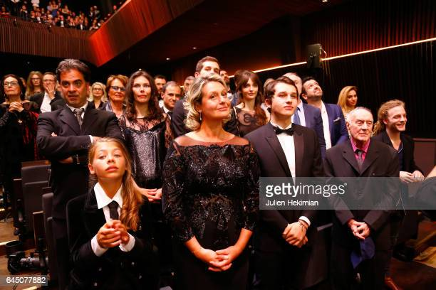 Stella Belmondo Luane Belmondo and guests stand up during the JeanPaul Belmondo Hommage during the Cesar Film Awards Ceremony at Salle Pleyel on...