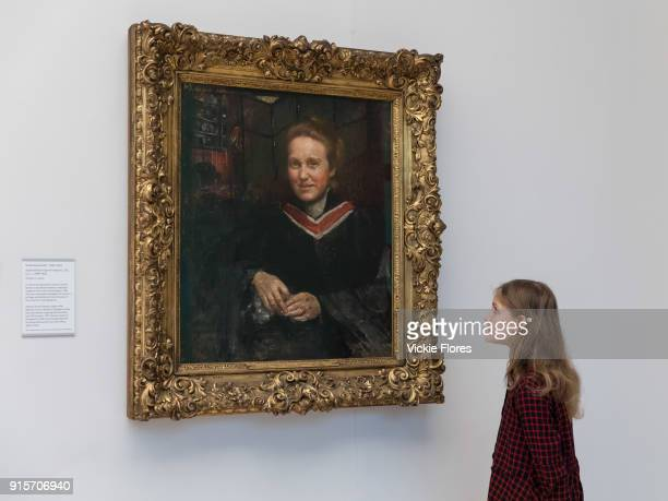 Stella Cartwright aged 9 views Annie Swynnertons oil portrait of the suffragist Millicent Fawcett which is displayed at Tate Britain art gallery on...