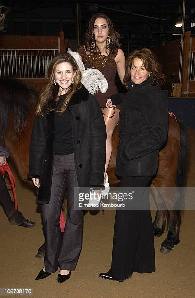 Stella Keitel and Lorraine Bracco during MercedesBenz Fashion Week Fall 2003 Collections Imitation of Christ Front Row at Chelsea Piers in New York...