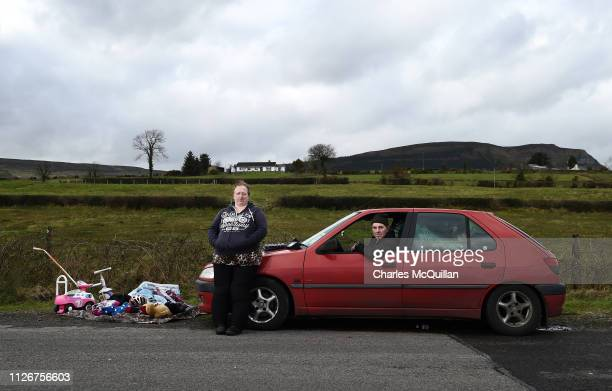 Stella Lynne and William Andrews pose for a photograph as they take part in the weekly market that takes place on the Irish border on February 17...