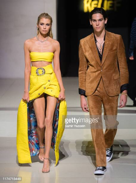 Stella Maxwell and Paris Brosnan walk the runway at the Fashion for Relief show during London Fashion Week September 2019 on September 14 2019 in...