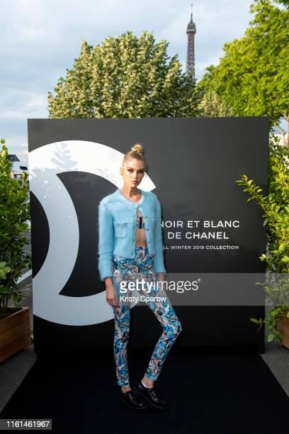 Stella Maxwell attends the Noir et Blanc de Chanel Fall/Winter 2019 Makeup Collection Yachts De Paris on July 11 2019 in Paris France