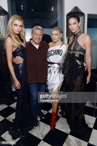 Stella Maxwell Edward Razek Fergie and Lily Aldridge attend The Daily Front Row and REVOLVE FLA after party at Mr Chow hosted by Mert Alas on April 2...