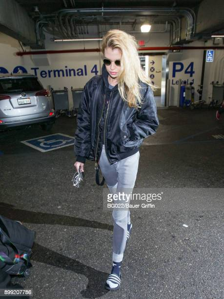 Stella Maxwell is seen at Los Angeles International Airport on December 27 2017 in Los Angeles California