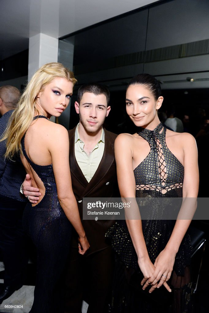 Stella Maxwell, Nick Jonas and Lily Aldridge attend The Daily Front Row and REVOLVE FLA after party at Mr. Chow hosted by Mert Alas on April 2, 2017 in Los Angeles, California.
