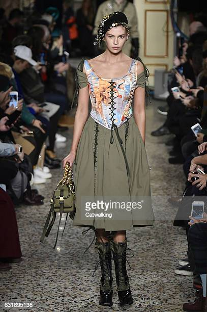 Stella Maxwell walks the runway at the Moschino Autumn Winter 2017 fashion show during Milan Menswear Fashion Week on January 14 2017 in Milan Italy