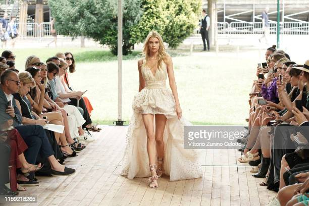 Stella Maxwell walks the runway during the Redemption Haute Couture Fall/Winter 2019 2020 show as part of Paris Fashion Week on June 30 2019 in Paris...
