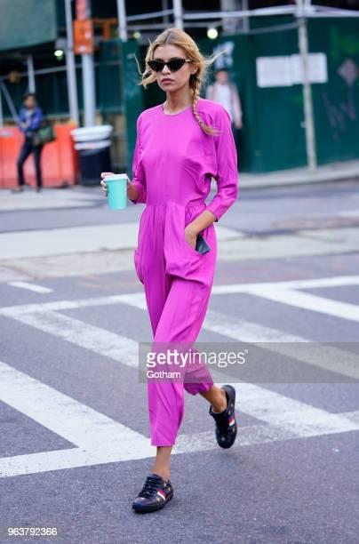 Stella Maxwell wears fuscia on May 30, 2018 in New York City.