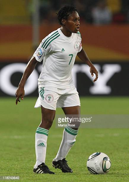 Stella Mbachu of Nigeria runs with the ball during the FIFA Women's World Cup 2011 Group A match between Canada and Nigeria at RudolfHarbigStadion on...