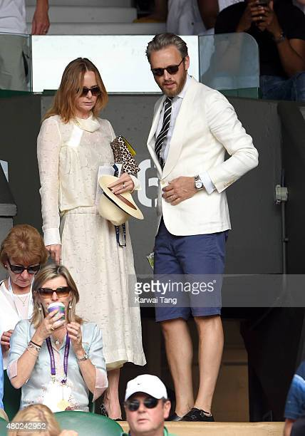 Stella McCartney and Alasdhair Willis attend day eleven of the Wimbledon Tennis Championships at Wimbledon on July 10 2015 in London England