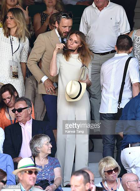 Stella McCartney and Alasdhair Willis attend the semifinal match between Noval Djokovic and Grigor Dimitrov on centre court at The Wimbledon...
