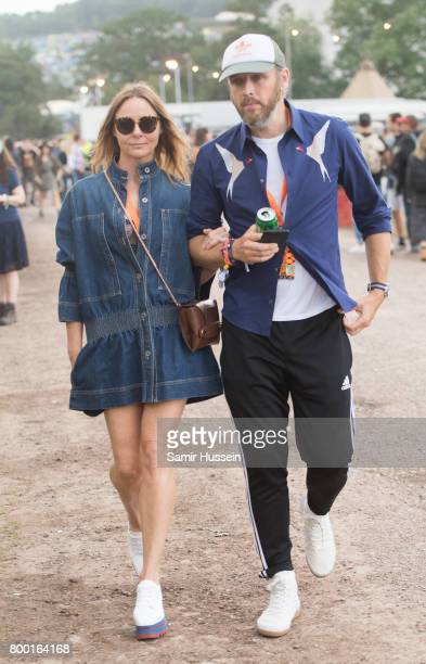 Stella McCartney and Alasdhair Willis attends day 2 of the Glastonbury Festival 2017 at Worthy Farm Pilton on June 23 2017 in Glastonbury England