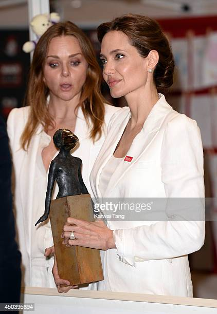 Stella McCartney and Angelina Jolie attend a photocall to launch War Child's 'Draw Me To Safety' campaign during the global conference to prevent...