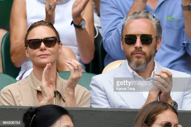 Stella McCartney and her husband Alasdhair Willis attend day seven of the Wimbledon Tennis Championships at the All England Lawn Tennis and Croquet...