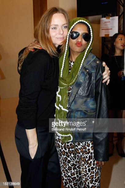 Stella McCartney and MIA pose backstage after the Stella McCartney Spring / Summer 2013 show as part of Paris Fashion Week on October 1 2012 in Paris...
