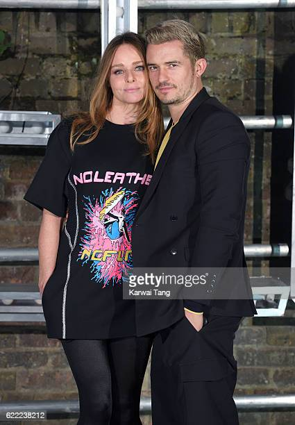 Stella McCartney and Orlando Bloom arrive for the Stella McCartney Resort collection and menswear launch at Abbey Road Studios on November 10 2016 in...