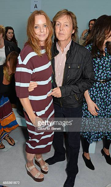 Stella McCartney and Sir Paul McCartney attend the Hunter Original SS 2015 catwalk show at on September 13, 2014 in London, England.