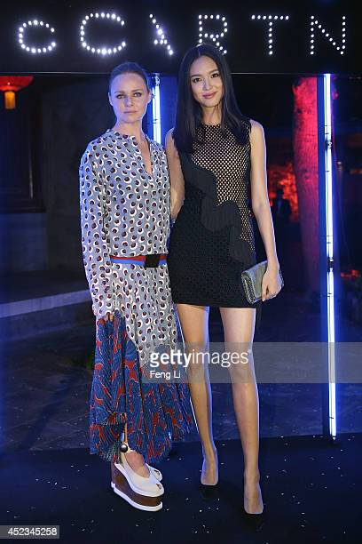Stella McCartney and Zhang Zilin Miss World 2007 pose during the presentation of the World of Stella McCartney collections at Shichahai Club on July...