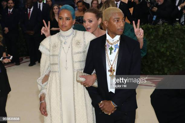 Stella McCartney photobombs Pharrell Williams and Helen Lasichanh at Heavenly Bodies Fashion the Catholic Imagination the 2018 Costume Institute...