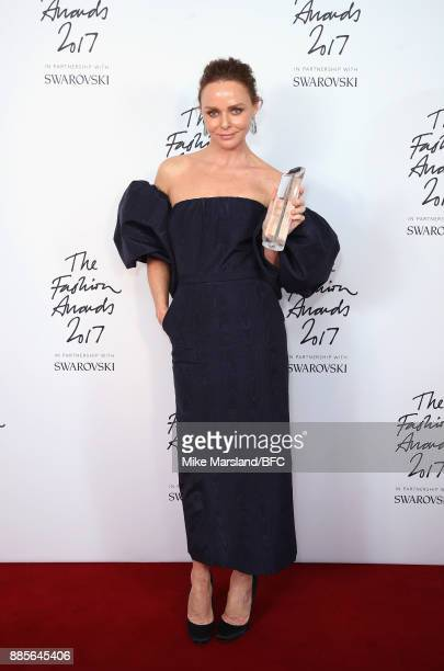 Stella McCartney poses in the winners room with the Special Recognition Award for Innovation during The Fashion Awards 2017 in partnership with...