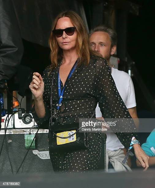 Stella McCartney watches Pharrell Williams at the Glastonbury Festival at Worthy Farm Pilton on June 27 2015 in Glastonbury England