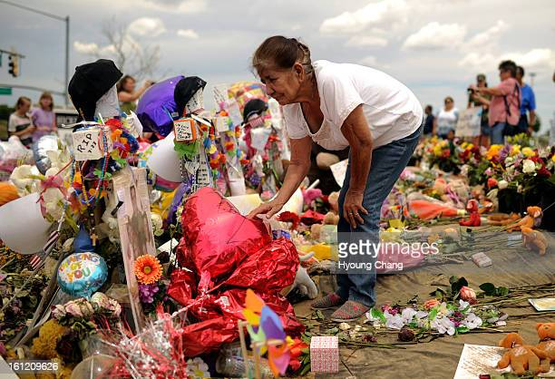 Stella Palomo of Commerce City is visiting flower covered memorials for shooting victims in Aurora, CO. Friday, July 27, 2012. Hyoung Chang, The...