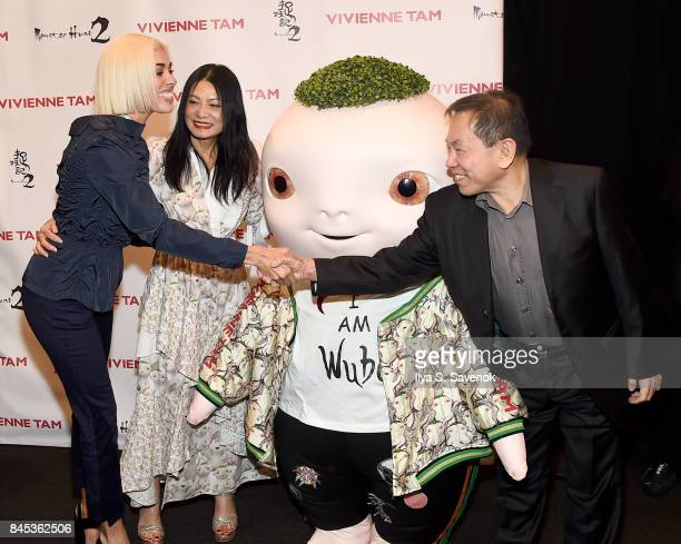 Stella Santana designer Vivienne Tam and producer William Kong poes with Wuba backstage for Vivienne Tam fashion show during New York Fashion Week...